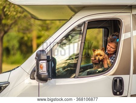 Retired Woman Traveling With Her Australian Silky Terrier Dog Pet Inside Camper Van Motorhome. Vacat