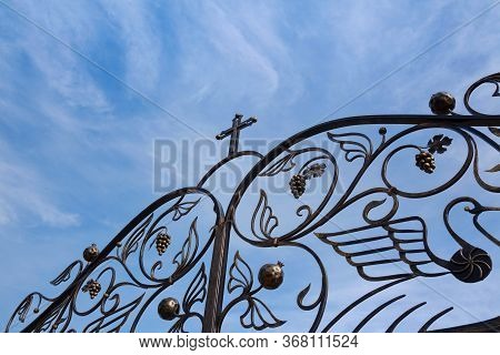 Church Forged Gate Against The Sky, Religion