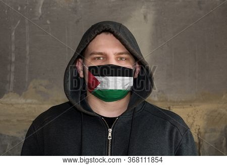 Man Wearing A Hood And A Palestine Flag Mask To Protect Him Coronavirus.