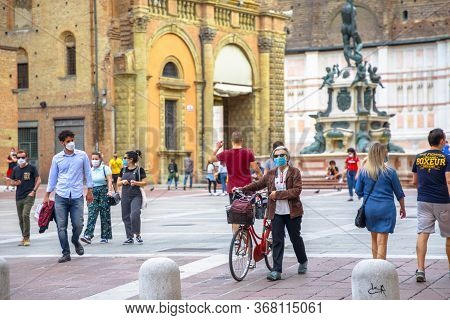 Bologna, Italy - May 9, 2020: Bikes And People With Surgical Mask In Piazza Maggiore Central Square