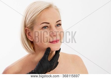 Beautician Examines A Woman's Face With Age Wrinkles - Aging And Skin Care Concept
