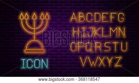 Glowing Neon Line Hanukkah Menorah Icon Isolated On Brick Wall Background. Hanukkah Traditional Symb