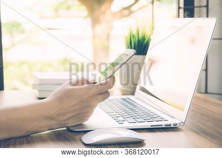 Hand Of Business Man Working From Home Using Laptop Computer To Internet Online On Desk, Lifestyle O