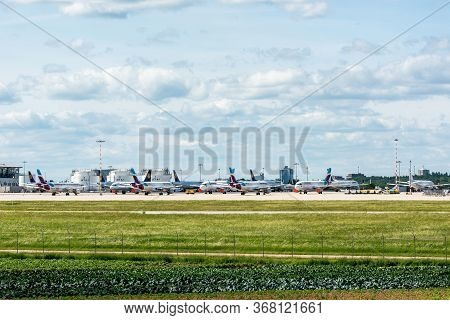 Lufthansa And Eurowings Aircraft Are Parked At The Runway Of Stuttgart Airport With Turbines Sealed