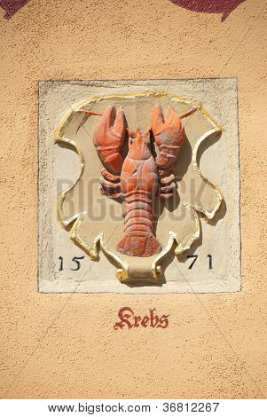 old Wall sculpture showing a lobster in Rothenburg Germany . Zodiac Sign poster
