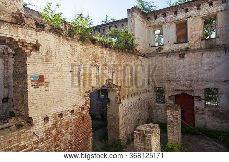 The Ruins Of An Old Brick Building, Ruined Walls, Old Wall Of A Ruined Red Brick House With Empty Wi