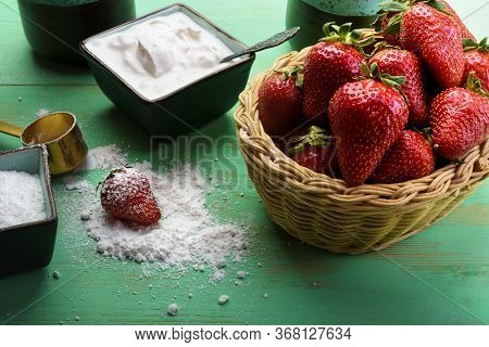 Strawberries In The Basket On The Wooden Table