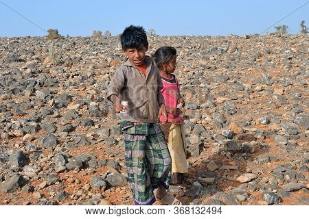 Socotra, Yemen - March 8, 2010: Young Boy And His Little Sister Sale A Box With Dragon Blood Trees W