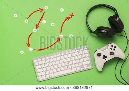 Keyboard, Headphones And Gamepad On A Green Background. Added Tactical Scheme Of The Game. The Conce