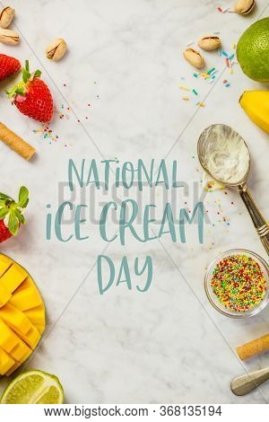National ice cream day 19 july concept. Top view of ice cream spoon and ingredients for assorted flavors on white marble background. Flat lay, text National Ice Cream Day