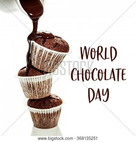 World Chocolate Day concept - 7 july. Muffins with chocolate sauce over white