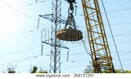 Image Of Big Electric Magnet Hanging On Crane On The Dump