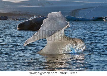 Glacial lake in Jokulsarlon with floating icebergs