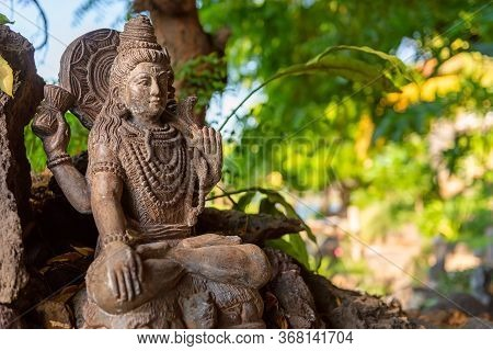 Traditional Stone Sculpture Of Hindu God Shiva. Outside Asian Style Interior. Interior Detail From A