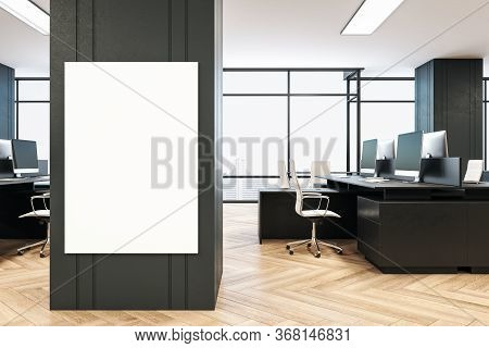 Modern Office Interior With Blank Vertical Banner On Wall, Daylight, Furniture And Equipment. Workpl