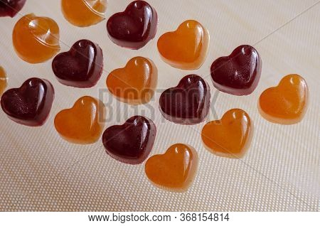 Homemade Gelatin Candies On Abeige Background. Jelly Candies With Blackcurrant Juice And Sicilian Or