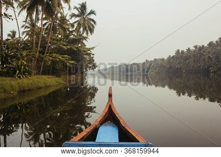 Wooden Boat On The Backwater Canals On A Background Of Tropical Forest With Palm Trees. Copy, Empty
