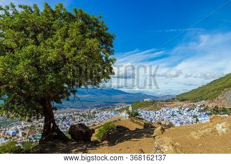 Scenic View On Chefchaouen, Morocco. Awe Landscape Overlooking On A Blue City Among Mountains. Lonel