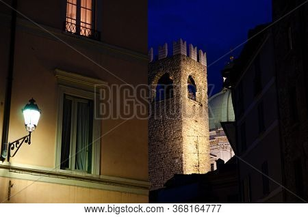 Dome Of Santa Maria Assunta New Cathedral, Tower Of Palazzo Del Broletto Palace And Street Light On