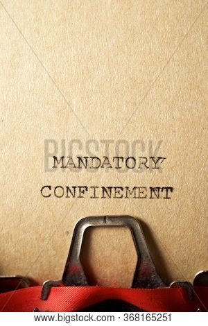 Mandatory confinement  text written on a paper.