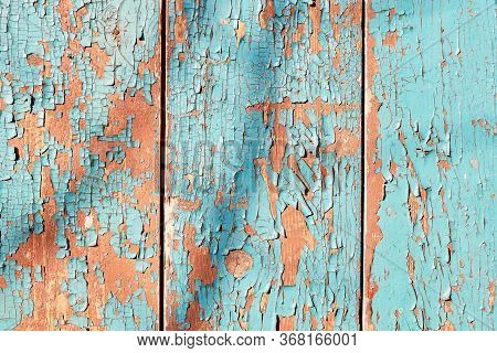 Aged Vertical Wood Board Background With Cyan And Orange Peeling Paint Texture. Frontal Close Up Det