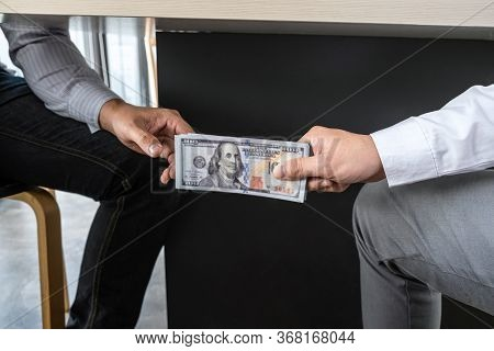 Dishonest Cheating In Business Illegal Money, Businessman Receive Bribe Money Under Table To Busines