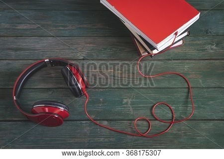 Headphones And A Stack Of Books On A Wooden Table. Audiobooks. Learning Via Audiobook.