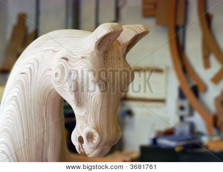 Carved wooden rocking horse head in workshop poster
