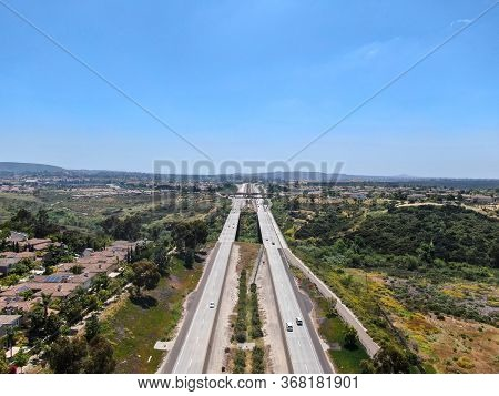 Aerial View Of Highway, Freeway Road With Vehicle In Movement With Blue Sky Baclground, California,