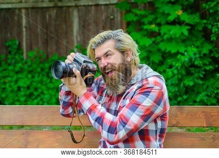 Take A Shoot. Photographer. Man Holding Camera. Videographer. Shooting Photo. Hipster With Camera In