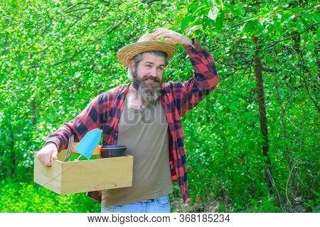 Spring. Smiling Man In Garden. Plants. Garden Tools. Gardening. Eco-farm. Work In Garden. Bearded Ma