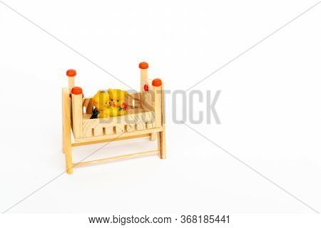 Toy Teddy Bears Sit Toy Beds. Toy Wooden Bed. Wooden Toy Bed With A Cute Pair Of Teddy Bears. Cute W