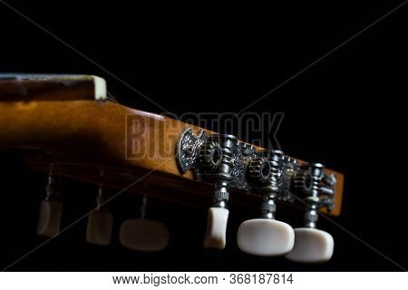 Machine Heads, Tuning Machines, Tuners Of Classical Spanish Guitar On A Black Background.