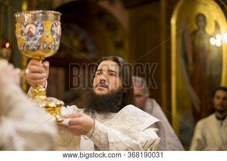 Kiev, Ukraine - 16 April 2017: The Divine Liturgy At The Kiev Holy Presentation Monastery. Deacon In
