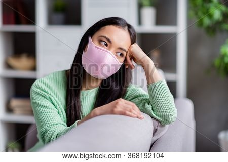 Photo Of Pretty But Sad Corona Virus Sick Patient Homey Asian Lady Sitting Couch Look Dreamy Window