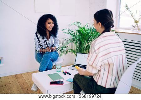 African American Positive Woman Talking With Colleague
