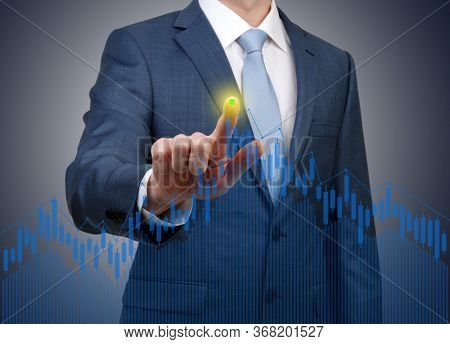 Businessman hand pushing business graph . Financial charts showing growing revenue on touch screen.