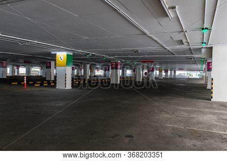 Empty Space Car Park Interior At Afternoon.indoor Parking Lot.interior Of Parking Garage With Car An