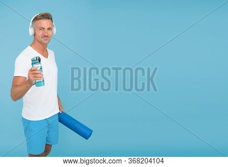 Health And Energy. Healthy Athlete Hold Water For Yoga Training. Fitness Coach Blue Background. Wate