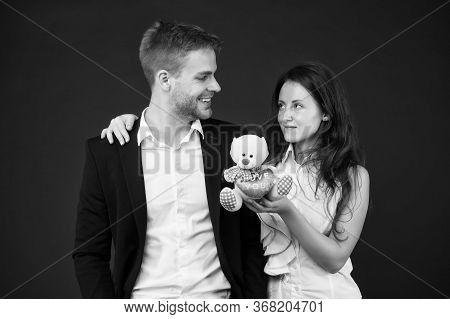 This Is Love. Love And Romance. Gift With Love. Couple On Romantic Date. Formal Couple With Toy Bear