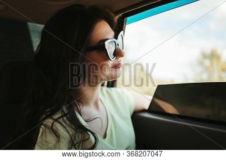 Young Delighted Woman Traveling By Car. Road Car Trip Lifestyle, Destination And Travel Concept