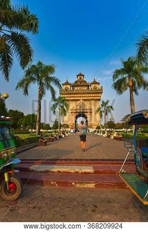 Tourist In Laos Woman Backpacker Takes Picture Of Patuxai Monument Vientiane Laos