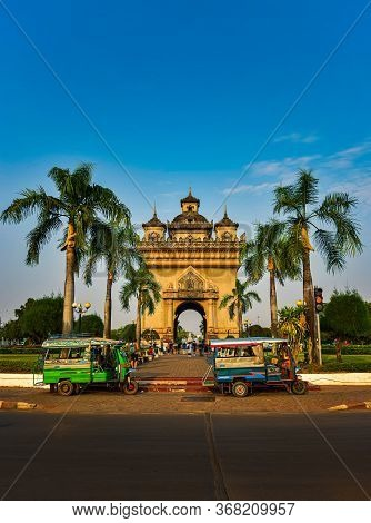 Auto Rickshaw In Front Of The Patuxai Monument In Vientiane Laos