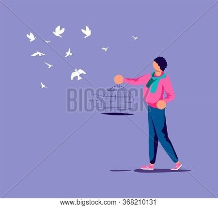 Man Lets Out The Flock Of Birds From A Cage. Freedom And Happiness Metaphor. Isolated On Purple. Fla