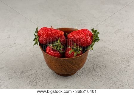 A Top View Red Strawberries Fresh Mellow Juicy Inside Brown Pot On The Grey Background