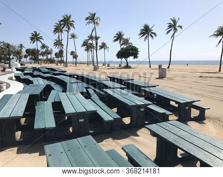 Fort Lauderdale, Fl / Usa - May 21:  Picnic Tables Are Stacked And Made Unusable As The Beach Remain
