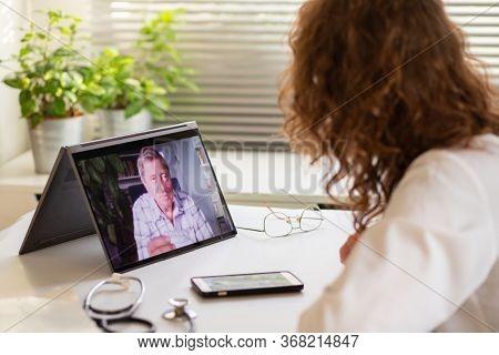 telemedicine concept elderly man in an online consultation
