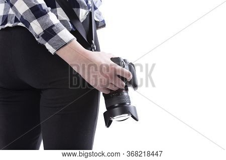 Close up view of unbranded lens and camera carried by a self-employed female gig photographer or art