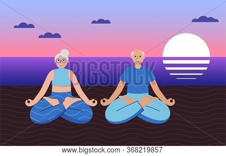 Happy Senior Couple Performs Yoga Lotus Position On The Seashore During Sunset. No Stress Old People