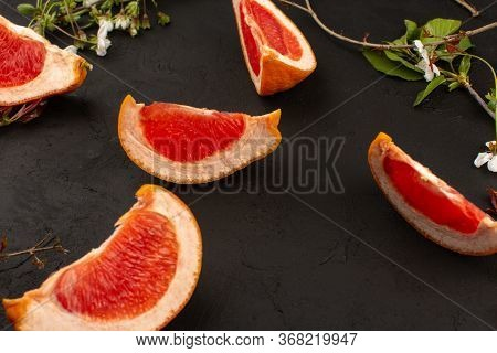 A Top View Fresh Grapefruit Slices Mellow Ripe Juicy Isolated On The Dark Floor